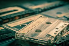 Closeup of old audio cassettes. On grey table stock photography