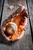 Closeup of old baseball glove and ball Stock Photos