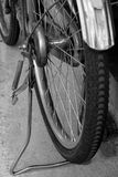 Closeup old bicycle wheel in black and white background Stock Photo