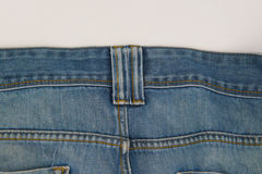Closeup old blue jeans texture for background Stock Image