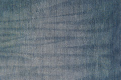 Closeup old blue jeans texture for background Royalty Free Stock Image