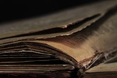 Closeup of an old book. Fragment of an old book page royalty free stock images