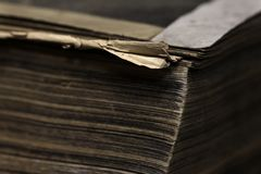 Closeup of an old book. Fragment of an old book page stock photo