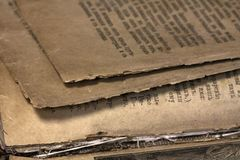 Closeup of an old book. Fragment of an old book page stock photos