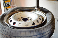 Closeup of old broken wheel with dirty tyre in Stock Images