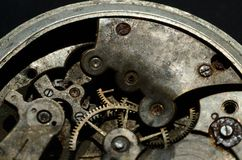 Closeup of old clock mechanism, background for vintage design Stock Images