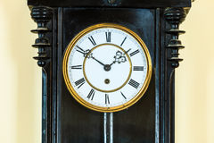 Closeup old clock on wall Royalty Free Stock Photo