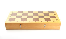 Closeup of an old closed wooden chessboard Royalty Free Stock Photography