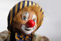 Closeup of an old clown puppet. Isolated Royalty Free Stock Photography