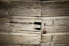 Closeup of old damaged wood planks texture background Stock Photos