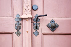 Closeup of an old door with handle and doorknob. Closeup of an old wooden door with handle and doorknob Royalty Free Stock Image