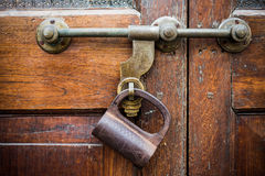 Closeup old door with lock in grungy style Royalty Free Stock Photography