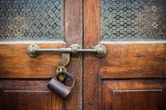 Closeup old door with lock in grungy style Royalty Free Stock Photos