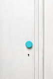 Closeup of an old door wardrobe. Knob and key hole. Empty space for text Royalty Free Stock Images