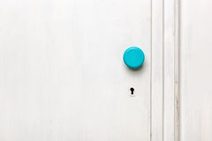 Closeup of an old door wardrobe. Knob and key hole. Empty space for text Royalty Free Stock Photo