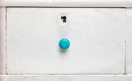 Closeup of an old door wardrobe. Knob and key hole. Empty space for text Royalty Free Stock Photos