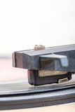 Closeup of old and dusty vinyl record player with arm and needle Stock Photo