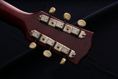 Closeup of old electric guitar. Detail, selective focus. Royalty Free Stock Photography
