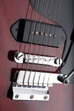 Closeup of old electric guitar. Detail, selective focus. Royalty Free Stock Images