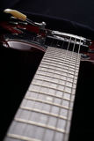 Closeup of old electric guitar. Detail, selective focus. Royalty Free Stock Photo