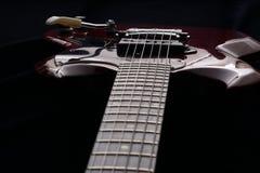 Closeup of old electric guitar. Detail, selective focus. Stock Photos