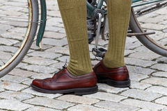 Closeup of old fashioned leather shoes and green stockings Royalty Free Stock Photo
