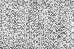 Antique printed damask repeat pattern. A closeup of an old fashioned shabby grey and white   small damask pattern printed on a paper background Stock Image