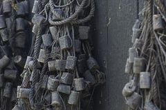 Old fishing nets hanging on a wall royalty free stock image