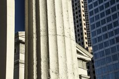 Closeup Old Historic Architecture Capitol Courthouse Building Round Columns. In Bright Sunlight with Modern Skyscraper Buildings in Background stock photography