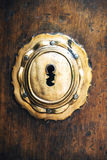 Closeup of an old key lock on a wooden antique door. Texture bac Stock Photo