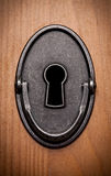 Closeup of an old keyhole Stock Photos