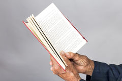 Closeup of old man hands holding an open book Stock Photography