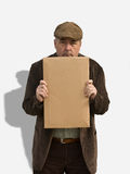 Closeup of Old Man Holding Sign Royalty Free Stock Photo