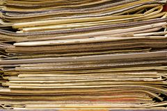 Closeup of old newspapers and magazines, stack, side view royalty free stock photo