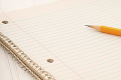 Closeup of Old Notebook of off white, lined paper with a pencil with room or space for your words, text or copy. Horizontal of an old notebook of lined paper Royalty Free Stock Image