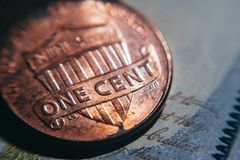 Old one cent coin. Business and Finance. Closeup of old one-cent coins. Coins and bills, the national currency of the United States. Income and expenses stock photo