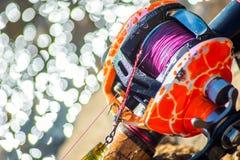 Closeup old orange color fishing reel Royalty Free Stock Photo