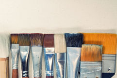 Closeup old paint brushes. Stock Photo