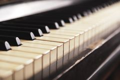 Closeup of old piano keyboard, selective focus, soft toning. Background with antique piano stock images