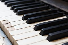 Closeup of old piano keyboard shallow focus stock images