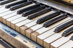Closeup of old piano keyboard shallow focus Royalty Free Stock Photos