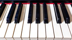 Closeup of old piano keys. The idea of the concept for love of music and musical inspiration stock image