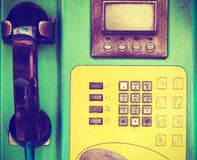 Closeup of old public telephone in phonebooth Royalty Free Stock Photo