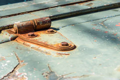 Closeup old rusty car hinge Royalty Free Stock Images