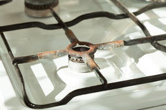 Closeup of old rusty gas stove in domestic kitchen Stock Photography