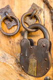 Closeup of an old rusty lock on the wooden door in Montenegro Royalty Free Stock Photography
