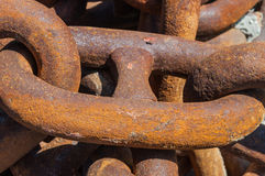 Closeup of an old and rusty but solid chain Royalty Free Stock Photos