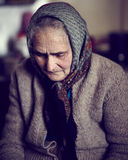 Closeup of an old sad woman indoor Royalty Free Stock Photos