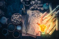 Old scrolls and recipe in vintage laboratory stock photography