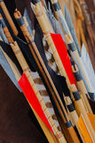 Closeup old set of Medieval arrows with bright plumage Stock Image